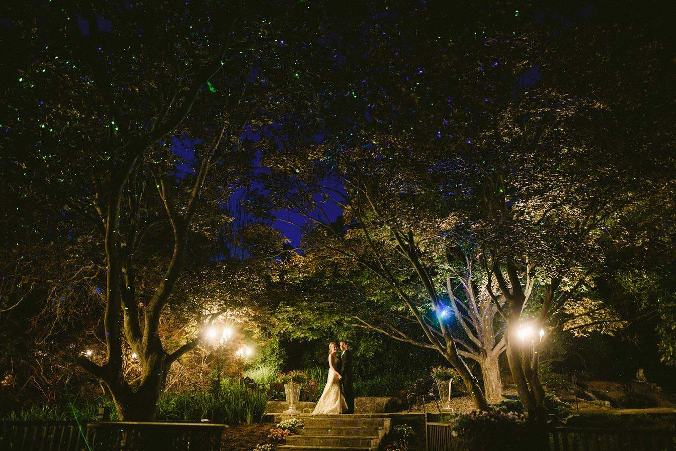 Rebecca and Chris in the gardens at night (Couple of Dudes Photography)