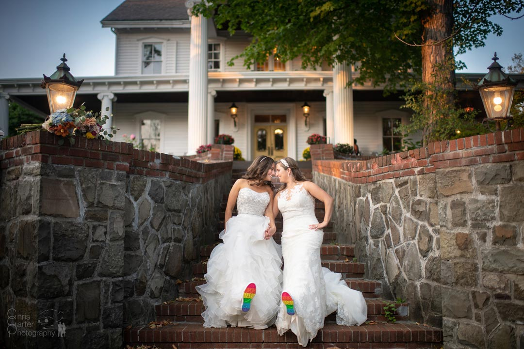 Two Brides in front of Historic Mansion Wedding Venue